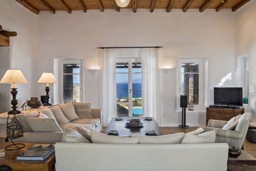 The living room with a view to the pool, to Agrari beach and to the island of Naxos